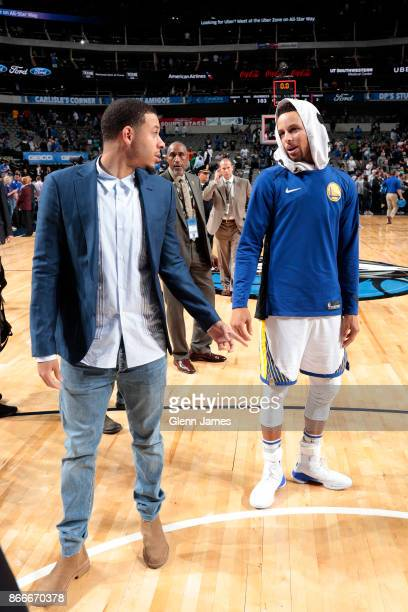 Seth Curry of the Dallas Mavericks and Stephen Curry of the Golden State Warriors greet each other after the game on October 23 2017 at the American...