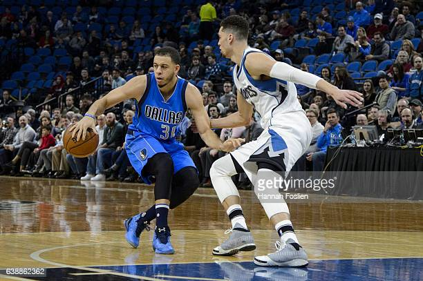 Seth Curry of the Dallas Mavericks dribbles the ball against Zach LaVine of the Minnesota Timberwolves during the game on January 9 2017 at the...