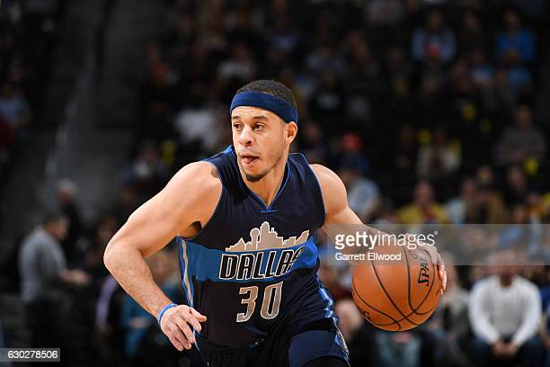 Seth Curry of the Dallas Mavericks handles the ball against the Denver Nuggets on December 19 2016 at the Pepsi Center in Denver Colorado NOTE TO...