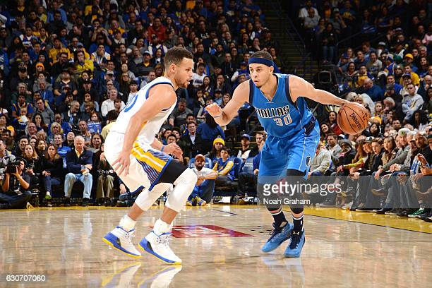 Seth Curry of the Dallas Mavericks handles the ball during the game against Stephen Curry of the Golden State Warriors on December 30 2016 at ORACLE...