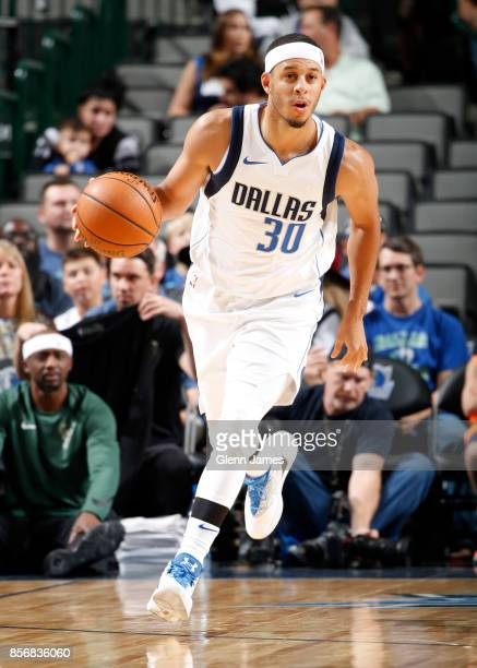Seth Curry of the Dallas Mavericks handles the ball during the preseason game against the Milwaukee Bucks on October 2 2017 at the American Airlines...
