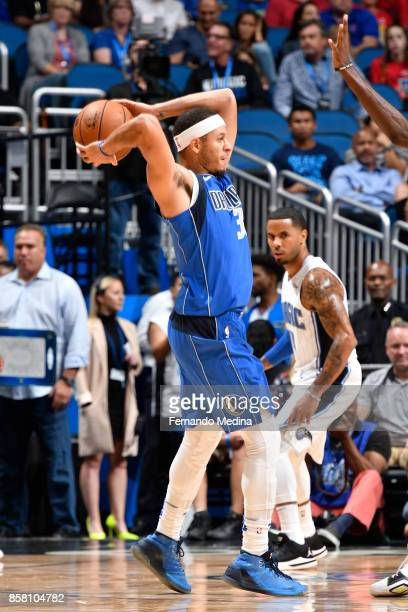 Seth Curry of the Dallas Mavericks looks to pass against the Orlando Magic during a preseason game on October 5 2017 at Amway Center in Orlando...