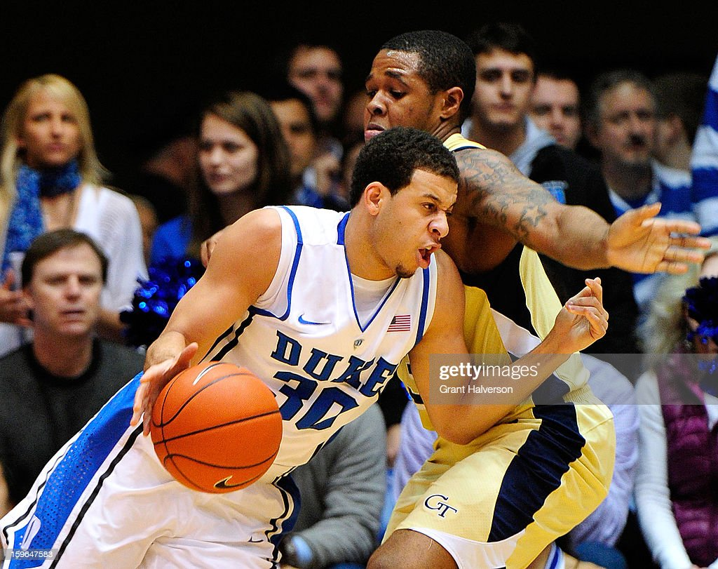 Seth Curry #30 of the Duke Blue Devils drives against Marcus Georges-Hunt #3 of the Georgia Tech Yellow Jackets during play at Cameron Indoor Stadium on January 17, 2013 in Durham, North Carolina.