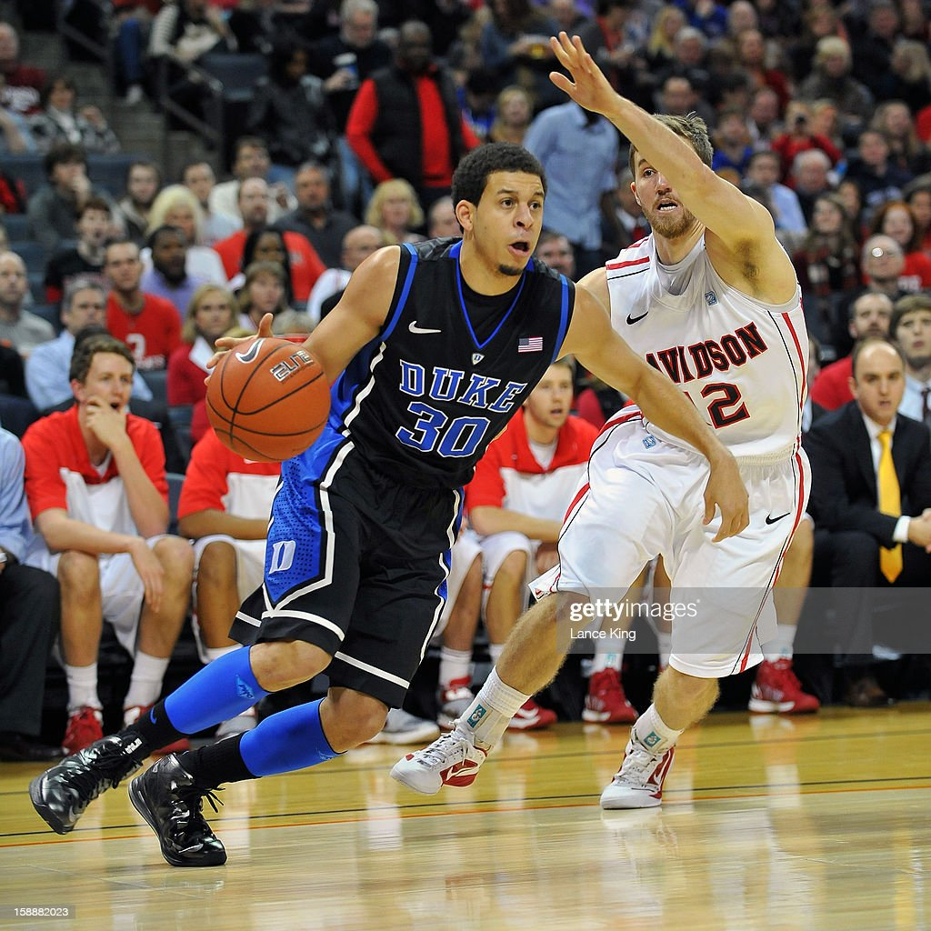 Seth Curry #30 of the Duke Blue Devils drives against Nik Cochran #12 of the Davidson Wildcats at Time Warner Cable Arena on January 2, 2013 in Charlotte, North Carolina.