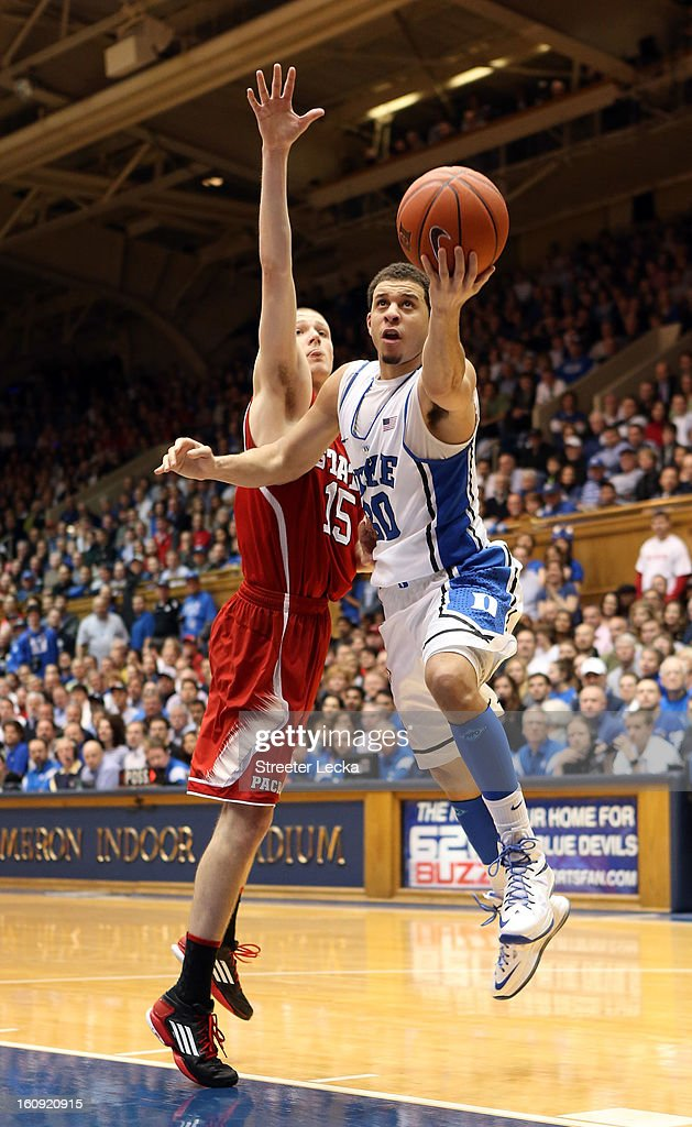 Seth Curry #30 of the Duke Blue Devils drives past Scott Wood #15 of the North Carolina State Wolfpack during their game at Cameron Indoor Stadium on February 7, 2013 in Durham, North Carolina.