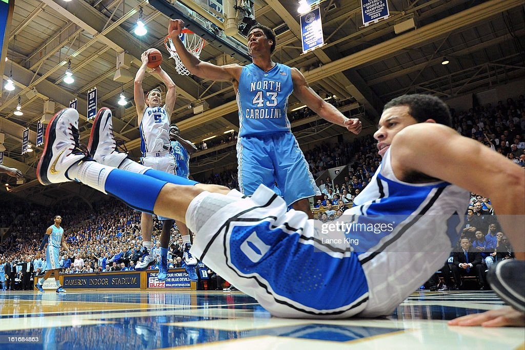 Seth Curry #30 of the Duke Blue Devils falls to the floor following a foul by James Michael McAdoo #43 of the North Carolina Tar Heels at Cameron Indoor Stadium on February 13, 2013 in Durham, North Carolina. Duke defeated North Carolina 73-68.