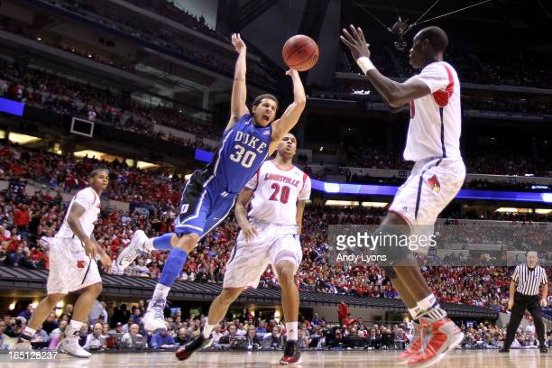 Seth Curry of the Duke Blue Devils loses the ball as he drives in the second half past Wayne Blackshear of the Louisville Cardinals during the...