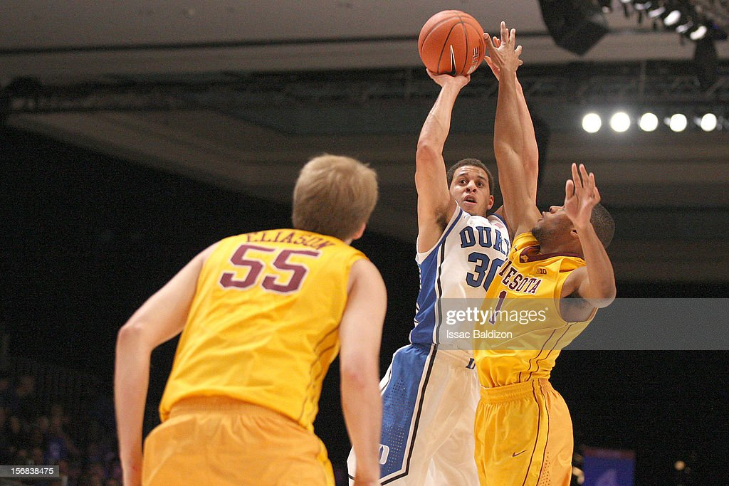 Seth Curry #30 of the Duke Blue Devils shoots against Joe Coleman #11 of the Minnesota Gophers during the Battle 4 Atlantis tournament at Atlantis Resort on November 22, 2012 in Nassau, Paradise Island, Bahamas.