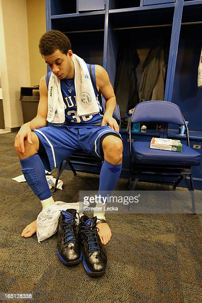 Seth Curry of the Duke Blue Devils sits in the locker room dejected after they lost to the Louisville Cardinals 8563 during the Midwest Regional...
