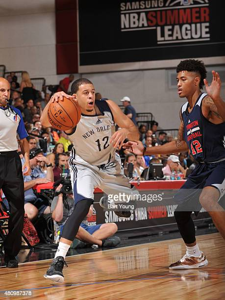 Seth Curry of the New Orleans Pelicans handles the ball against Kelly Oubre Jr #12 of the Washington Wizards on July 16 2015 at The Cox Pavilion in...