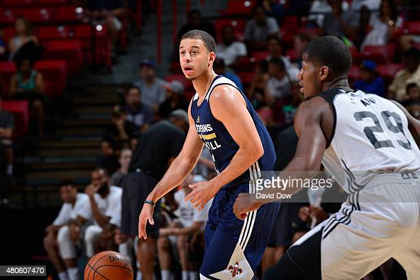 Seth Curry of the New Orleans Pelicans handles the ball against the Brooklyn Nets during the 2015 NBA Las Vegas Summer League game on July 13 2015 at...