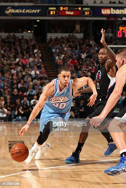 Seth Curry of the Sacramento Kings dribbles past Jamal Crawford of the Los Angeles Clippers at Sleep Train Arena on February 26 2016 in Sacramento...