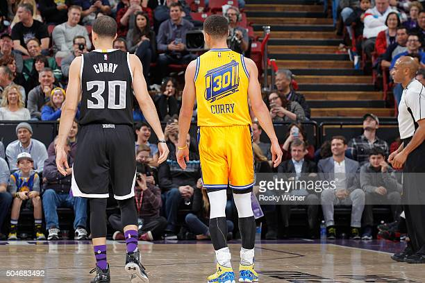 Seth Curry of the Sacramento Kings faces off against Stephen Curry of the Golden State Warriors on January 9 2016 at Sleep Train Arena in Sacramento...