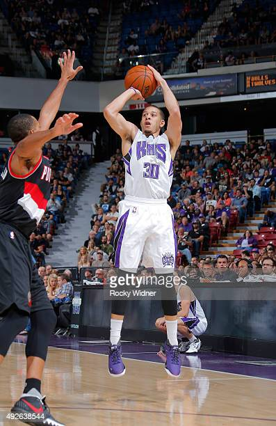 Seth Curry of the Sacramento Kings shoots a three pointer against the Portland Trail Blazers on October 10 2015 at Sleep Train Arena in Sacramento...