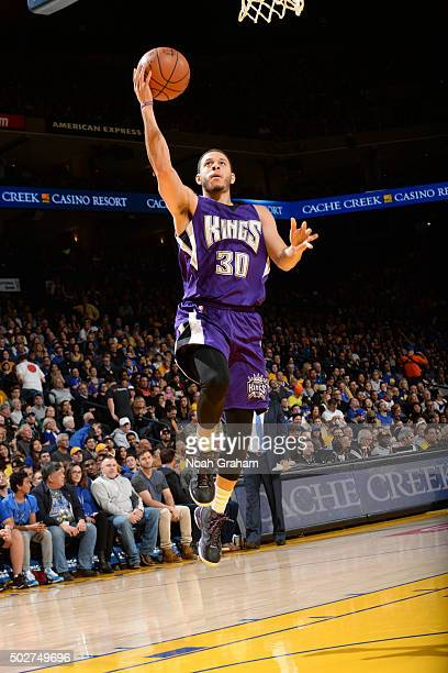 Seth Curry of the Sacramento Kings shoots the ball against the Golden State Warriors on December 28 2015 at ORACLE Arena in Oakland California NOTE...