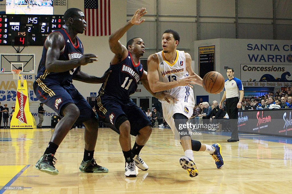 <a gi-track='captionPersonalityLinkClicked' href=/galleries/search?phrase=Seth+Curry&family=editorial&specificpeople=5945068 ng-click='$event.stopPropagation()'>Seth Curry</a> #13 of the Santa Cruz Warriors drive the ball to the basket against Aaron Johnson #11 of the Bakersfield Jam on November 30, 2013 at Kaiser Permanente Arena in Santa Cruz, California.