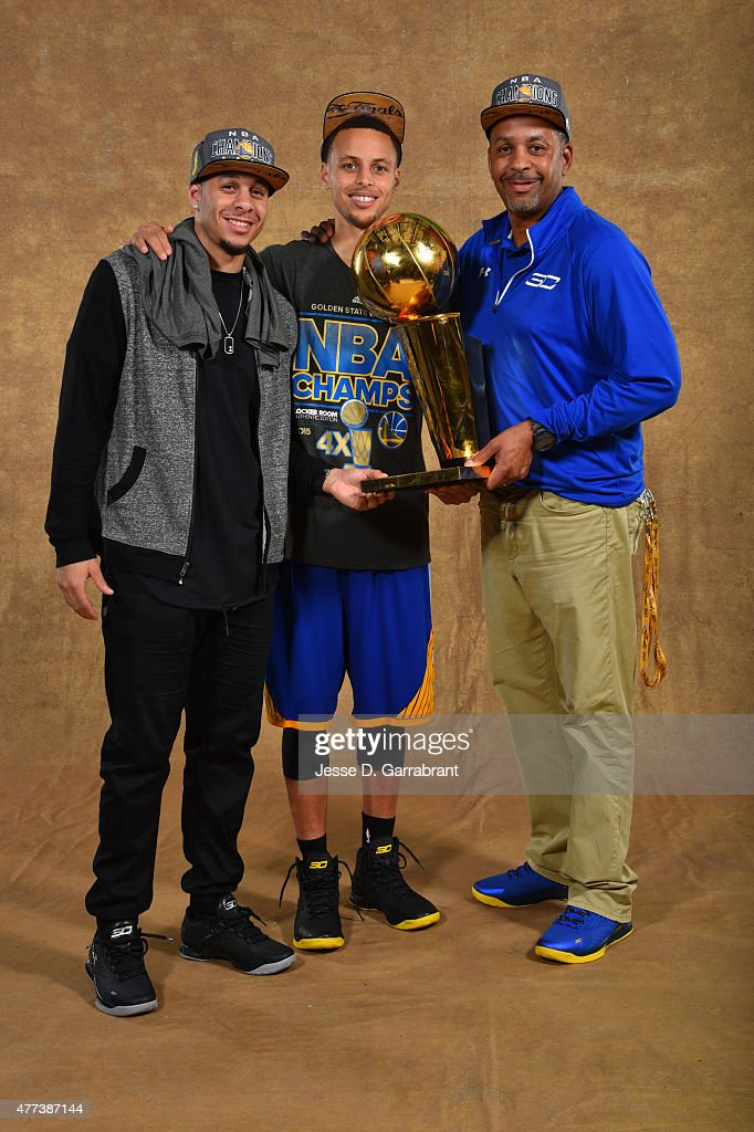 <a gi-track='captionPersonalityLinkClicked' href=/galleries/search?phrase=Seth+Curry&family=editorial&specificpeople=5945068 ng-click='$event.stopPropagation()'>Seth Curry</a>, <a gi-track='captionPersonalityLinkClicked' href=/galleries/search?phrase=Stephen+Curry+-+Basketball+Player&family=editorial&specificpeople=5040623 ng-click='$event.stopPropagation()'>Stephen Curry</a> #30 and <a gi-track='captionPersonalityLinkClicked' href=/galleries/search?phrase=Dell+Curry&family=editorial&specificpeople=788171 ng-click='$event.stopPropagation()'>Dell Curry</a> of the Golden State Warriors poses for a portrait with the Larry O'Brien trophy after defeating the Cleveland Cavaliers in Game Six of the 2015 NBA Finals on June 16, 2015 at Quicken Loans Arena in Cleveland, Ohio.