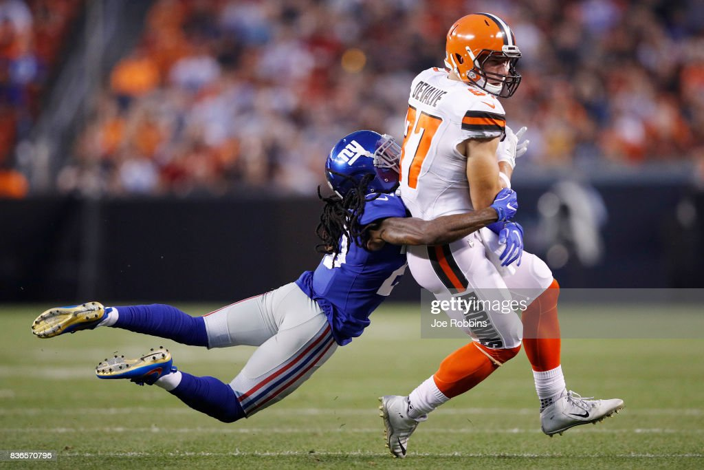 Seth DeValve #87 of the Cleveland Browns gets tackled after a reception against Janoris Jenkins #20 of the New York Giants in the first half of a preseason game at FirstEnergy Stadium on August 21, 2017 in Cleveland, Ohio.