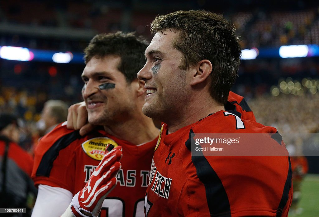 Seth Doege #7 (R) and Alex Torres #86 of Texas Tech celebrate on the field after defeating Minnesota 34-31 during the Meineke Car Care of Texas Bowl at Reliant Stadium on December 28, 2012 in Houston, Texas.