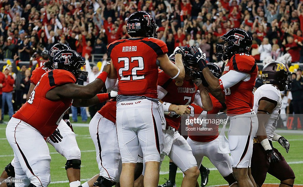 Seth Doege #7 of Texas Tech celebrates with his teammates after his a 4-yard touchdown in the second quarter against Minnesota during the Meineke Car Care of Texas Bowl at Reliant Stadium on December 28, 2012 in Houston, Texas.