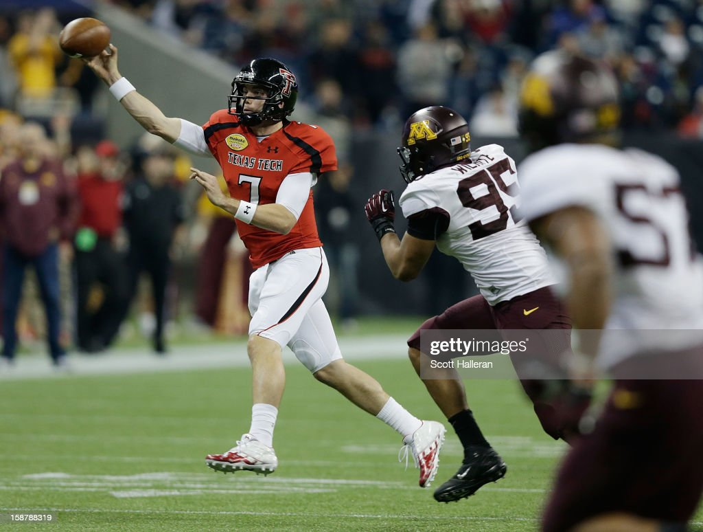 Seth Doege #7 of Texas Tech looks to pass against D.L. White #95 and Aaron Hill #57 of Minnesota during the Meineke Car Care of Texas Bowl at Reliant Stadium on December 28, 2012 in Houston, Texas.