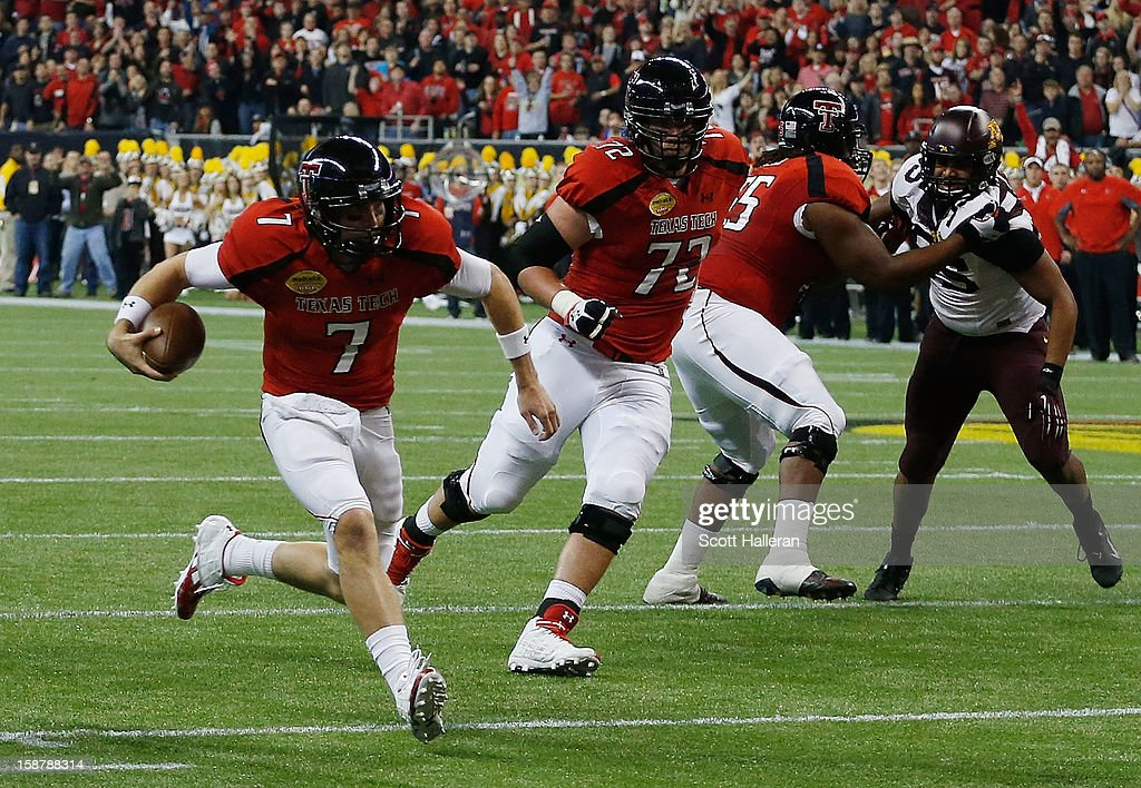 Seth Doege #7 of Texas Tech rushes for a 4 yards touchdown against Minnesota during the Meineke Car Care of Texas Bowl at Reliant Stadium on December 28, 2012 in Houston, Texas.
