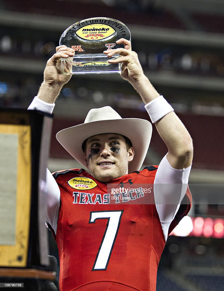 Seth Doege #7 of the Texas Tech Red Raiders holds up the MVP trophy as the Texas Tech Red Raiders beat the Minnesota Golden Gophers during the Meineke Car Care of Texas Bowl at Reliant Stadium on December 28, 2012 in Houston, Texas. Texas Tech defeated Minnesota 34-31.