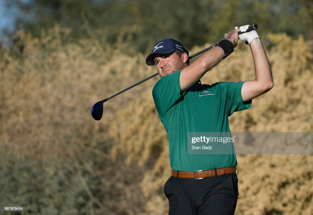 Seth Fair plays a tee shot on the ninth hole during the first round of the Web.com Tour Qualifying Tournament at Whirlwind Golf Club on the Devil's Claw course on December 7, 2017 in Chandler, Arizona.