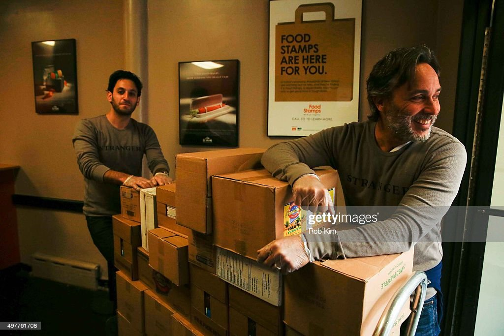 Seth Fisher and Grant Scharbo of 'Saints Strangers' volunteer at The Food Bank Of NYC Community Kitchen as part of National Geographic Channel and...