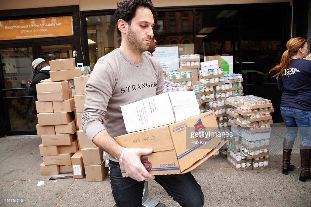Seth Fisher of 'Saints Strangers' volunteers at The Food Bank Of NYC Community Kitchen as part of National Geographic Channel and Feeding America's...