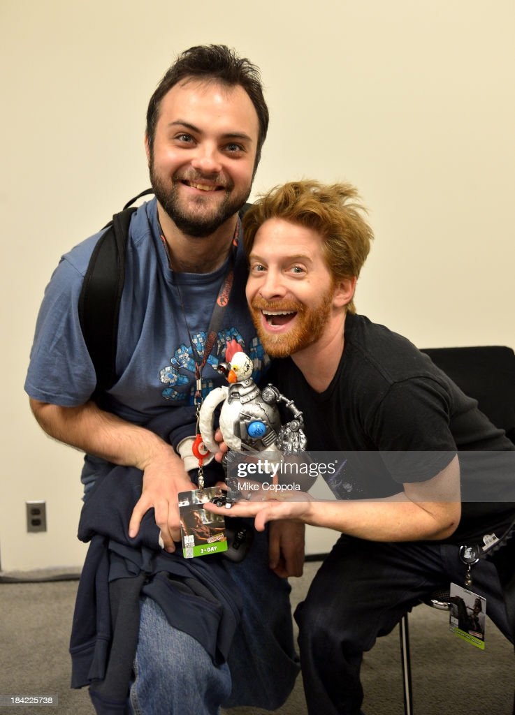 Seth Green and a guest attend the Robot Chicken Signing during New York Comic Con 2013 at the Javits Center on October 12 2013 in New York City...