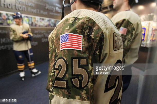 Seth Griffith of the Buffalo Sabres prepares to take the ice wearing a special jersey on Military Appreciation Night before an NHL game against the...