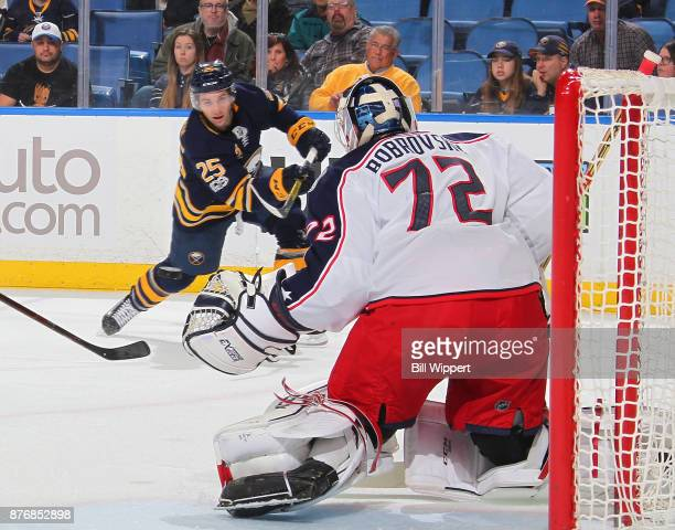 Seth Griffith of the Buffalo Sabres shoots the puck against Sergei Bobrovsky of the Columbus Blue Jackets during an NHL game on November 20 2017 at...