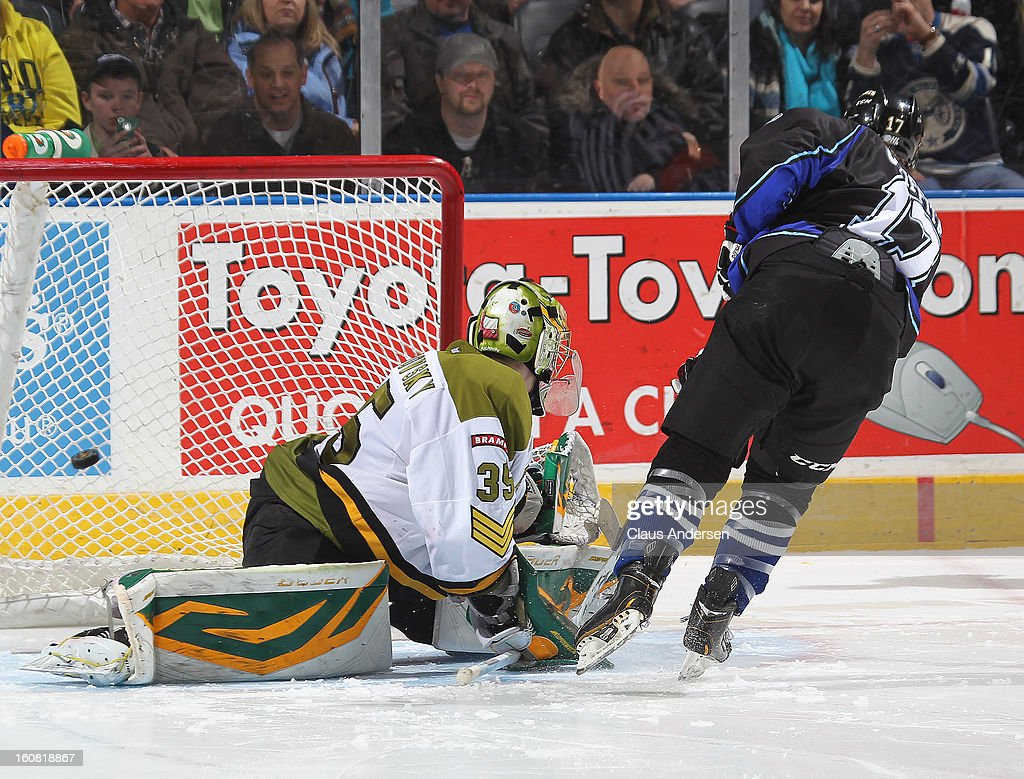 Seth Griffith #17 of the London Knights buries a shot in the shoot-out past Matej Machovsky of the Brampton Battalion in an OHL game on February 1, 2013 at the Budweiser Gardens in London, Canada. The Knights defeated the Battalion 1-0 in a shoot-out.