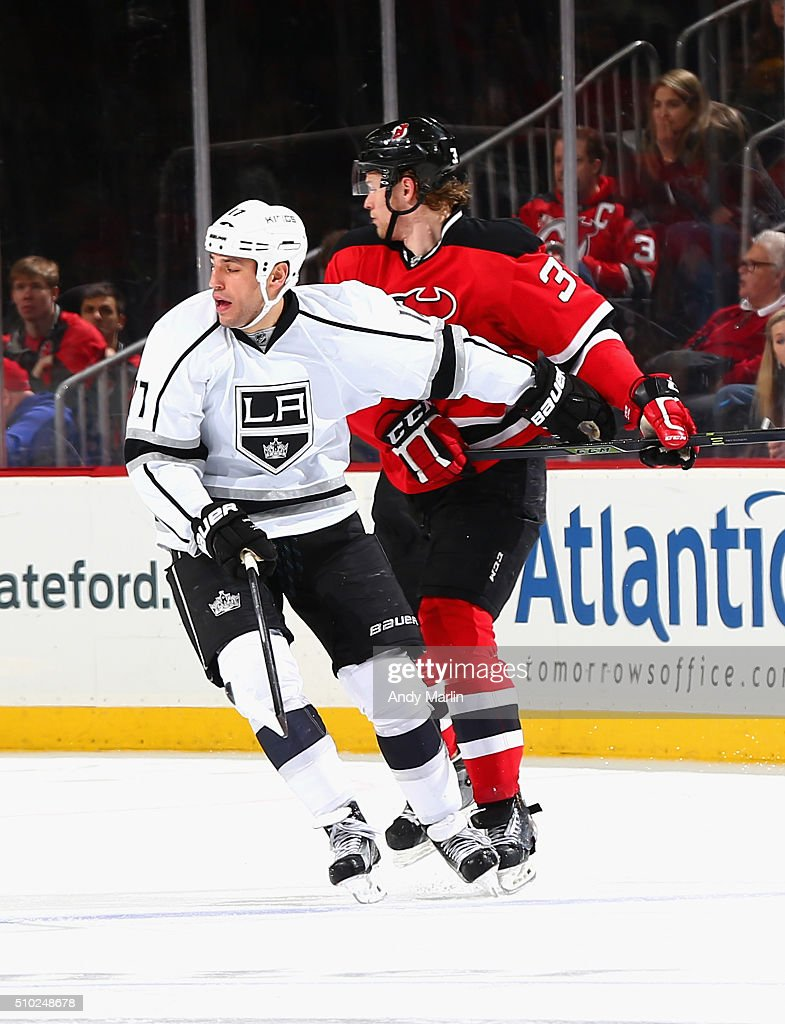 Seth Helgeson #39 of the New Jersey Devils comes together with Milan Lucic #17 of the Los Angeles Kings during the game at the Prudential Center on February 14, 2016 in Newark, New Jersey.