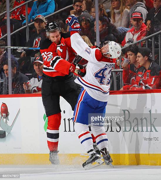 Seth Helgeson of the New Jersey Devils hits Paul Byron of the Montreal Canadiens during the second period at the Prudential Center on January 20 2017...