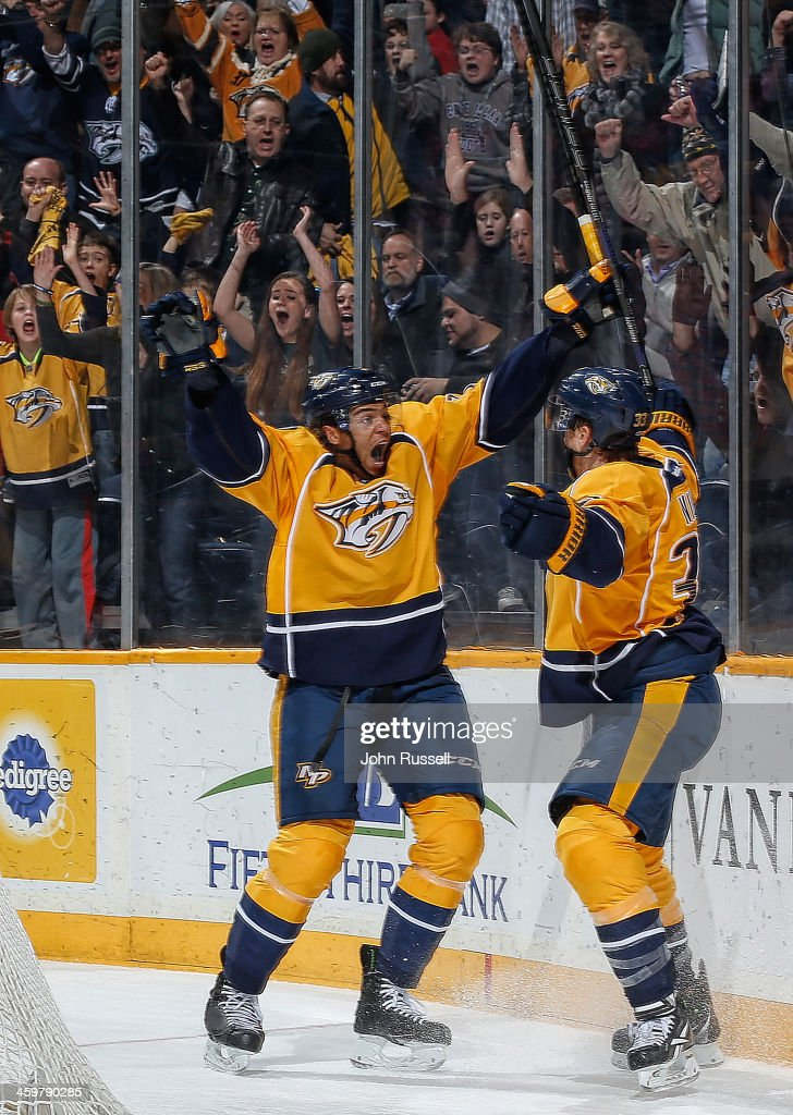 Seth Jones #3 and Colin Wilson #33 of the Nashville Predators celebrate a goal against the Detroit Red Wings at Bridgestone Arena on December 30, 2013 in Nashville, Tennessee.