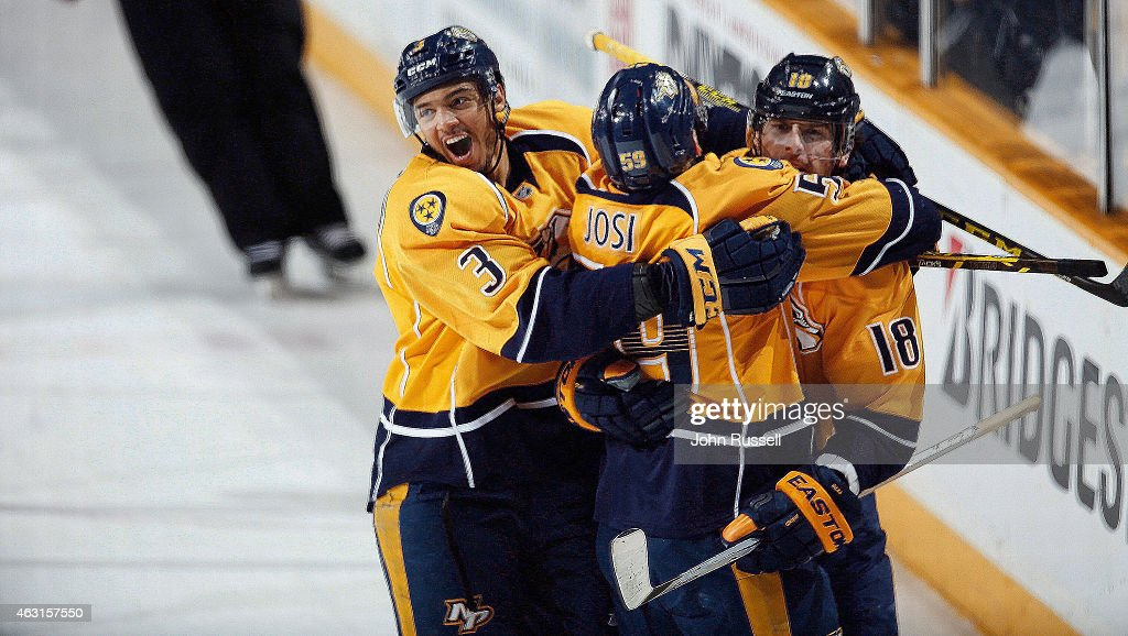 Seth Jones and Roman Josi celebrate with James Neal of the Nashville Predators after his overtime game winning goal against the Tampa Bay Lightning...
