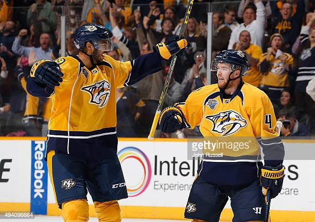 Seth Jones and Ryan Ellis of the Nashville Predators celebrate a goal against the Anaheim Ducks during an NHL game at Bridgestone Arena on October 22...