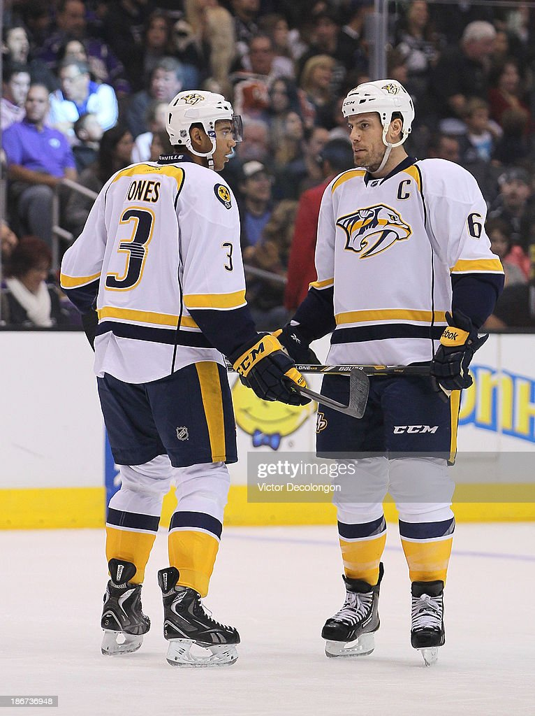Seth Jones #3 and <a gi-track='captionPersonalityLinkClicked' href=/galleries/search?phrase=Shea+Weber&family=editorial&specificpeople=554412 ng-click='$event.stopPropagation()'>Shea Weber</a> #6 of the Nashville Predators confer before an offensive zone face-off against the Los Angeles Kings during the NHL game at Staples Center on November 2, 2013 in Los Angeles, California. The Predators defeated the Kings 4-3.