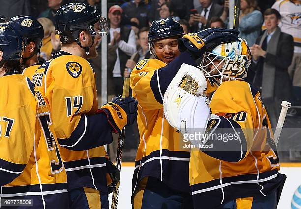 Seth Jones congratulates Carter Hutton of the Nashville Predators after a win against the Toronto Maple Leafs during an NHL game at Bridgestone Arena...