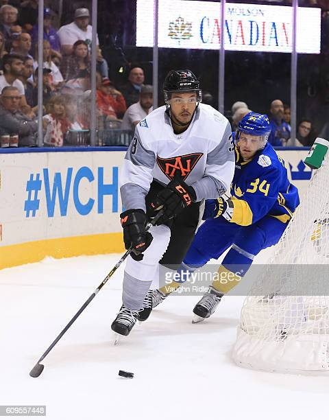 Seth Jones of Team North America stickhandles the puck with Carl Soderberg of Team Sweden chasing during the World Cup of Hockey 2016 at Air Canada...
