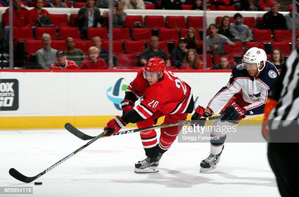 Seth Jones of the Columbus Blue Jackets attempts to lift the stick of Sebastian Aho of the Carolina Hurricanes during an NHL game on October 10 2017...