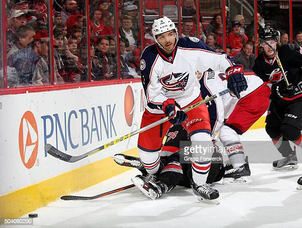 Seth Jones of the Columbus Blue Jackets battles to control the puck along the boards during an NHL game against the Carolina Hurricanes at PNC Arena...