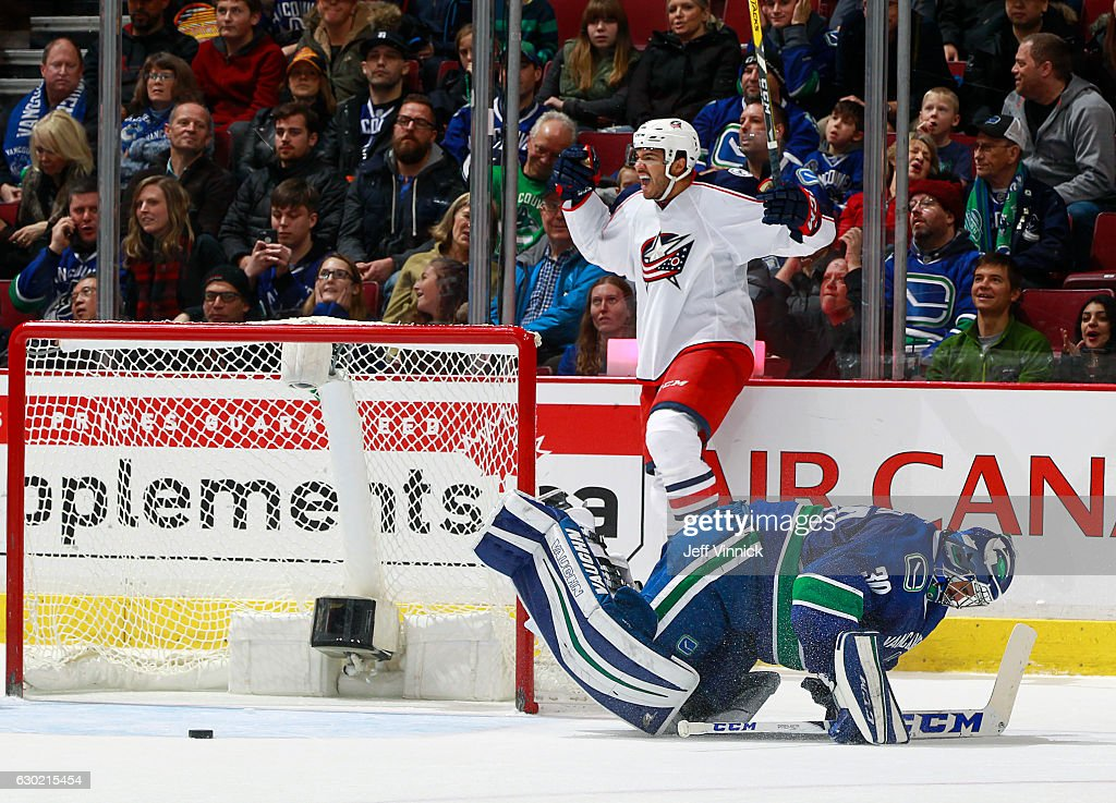 Seth Jones #3 of the Columbus Blue Jackets celebrates after scoring on Ryan Miller #30 of the Vancouver Canucks in overtime during their NHL game at Rogers Arena December 18, 2016 in Vancouver, British Columbia, Canada. Columbus won 4-3 in overtime.