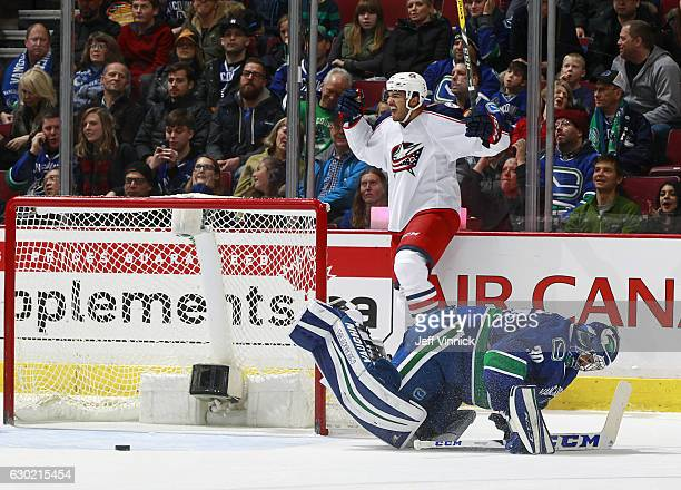 Seth Jones of the Columbus Blue Jackets celebrates after scoring on Ryan Miller of the Vancouver Canucks in overtime during their NHL game at Rogers...