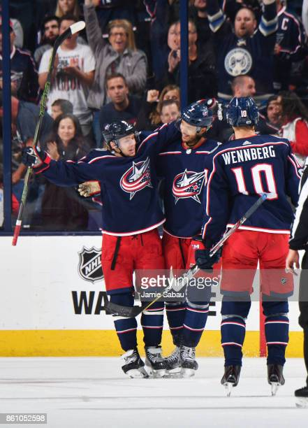 Seth Jones of the Columbus Blue Jackets celebrates his second period goal with teammates Artemi Panarin and Alexander Wennberg of the Columbus Blue...