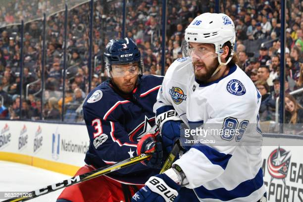 Seth Jones of the Columbus Blue Jackets checks Nikita Kucherov of the Tampa Bay Lightning during the second period of a game on October 19 2017 at...