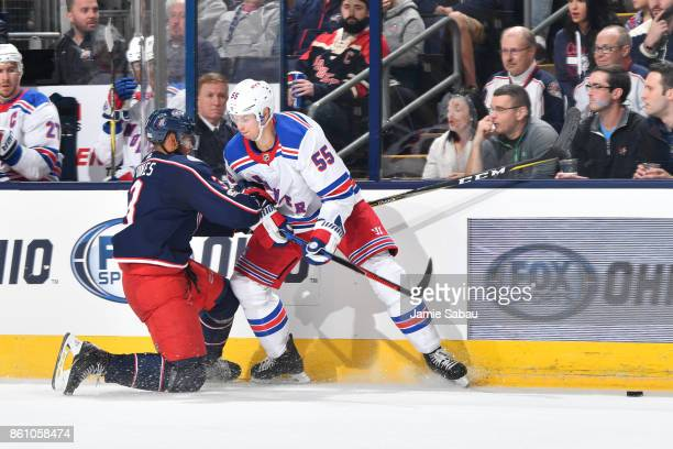 Seth Jones of the Columbus Blue Jackets collides with Nick Holden of the New York Rangers during the third period of a game on October 13 2017 at...