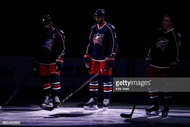 Seth Jones of the Columbus Blue Jackets is spotlit while being introduced to the crowd prior to the start of the game against the Winnipeg Jetson...